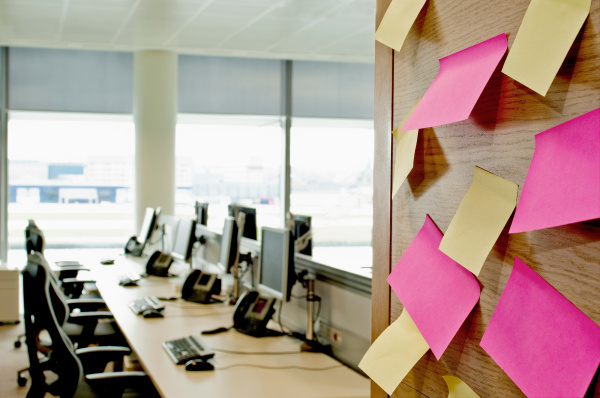sticky notes on wall in empty