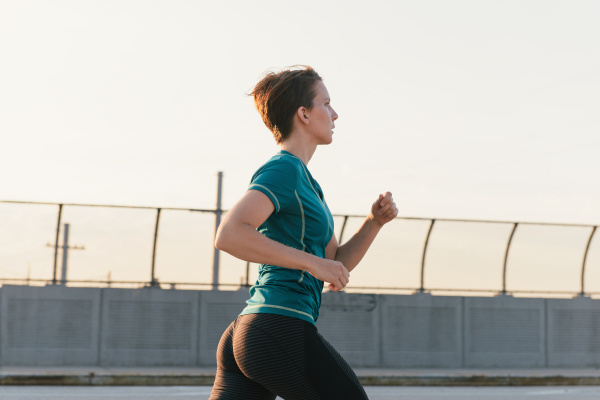 mid adult woman running outdoors