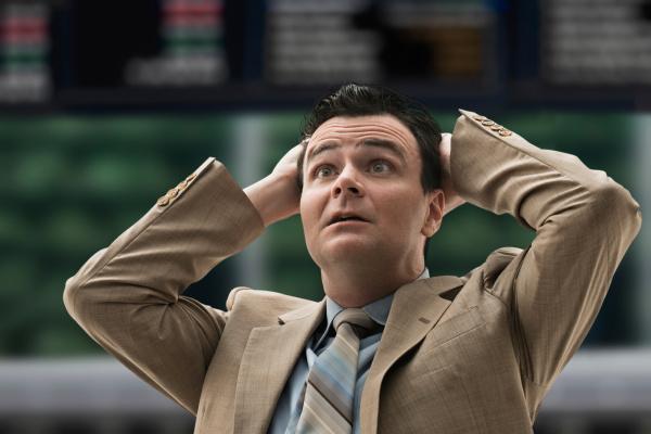stressed businessman at stock exchange