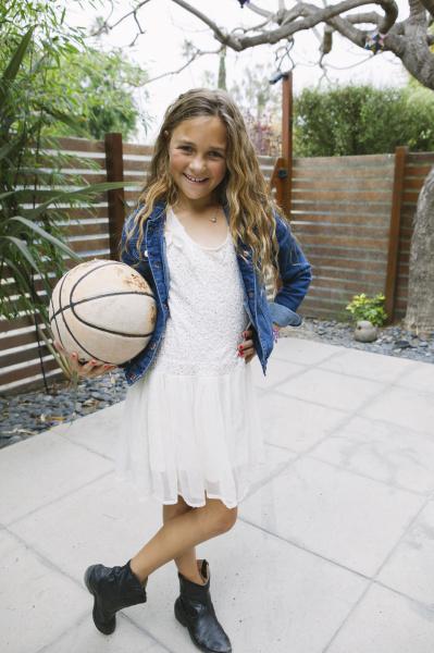 girl holding basketball portrait