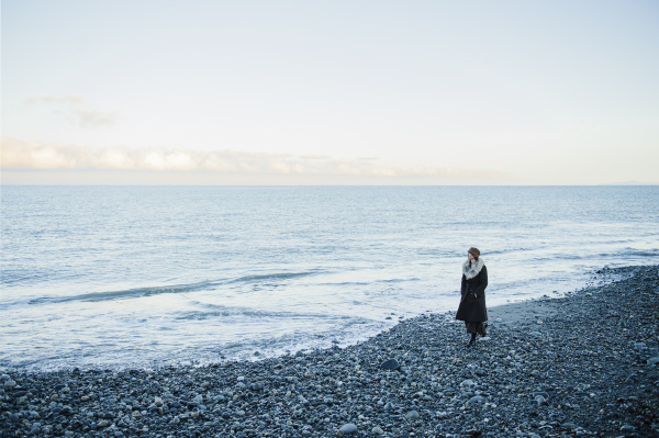 woman strolling on beach