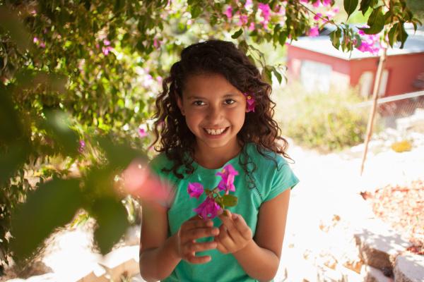 portrait of girl in garden holding