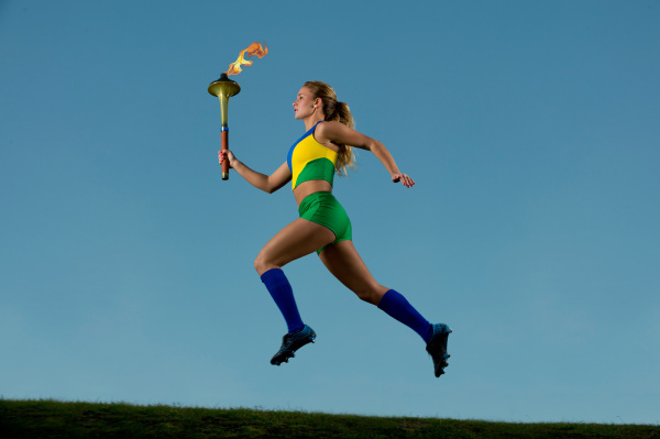 brazilian runner carrying olympic torch