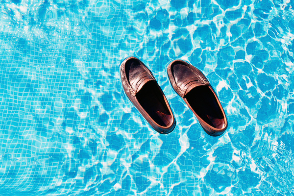 shoes floating in swimming pool