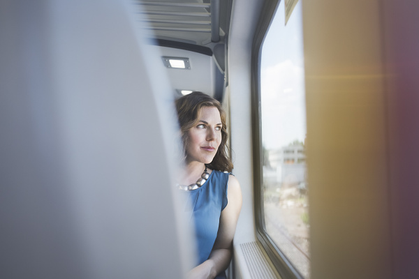 mid adult woman on train looking