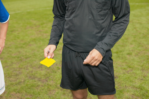 referee giving yellow card