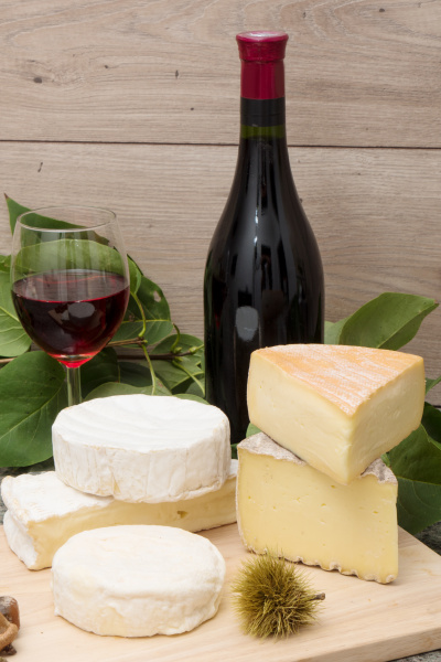 french cheese with a glass and