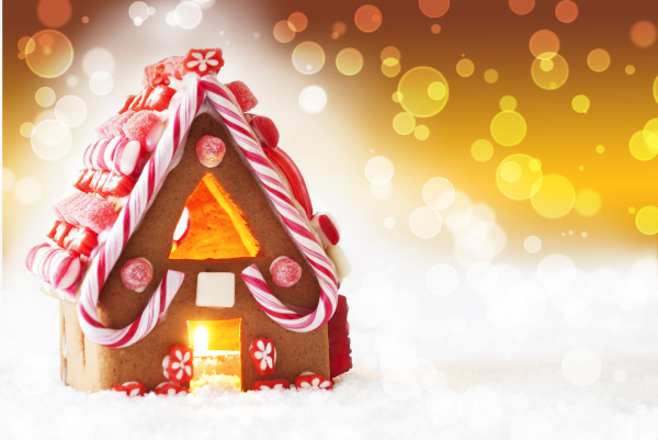 gingerbread house golden background with bokeh