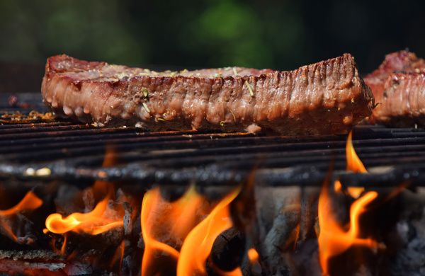 beef steak grilled on flame barbecue
