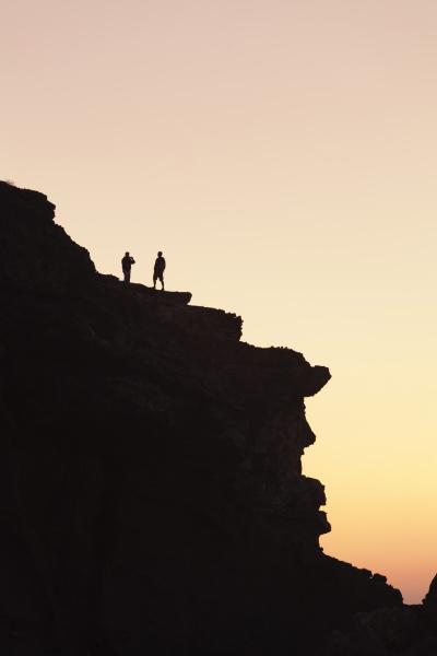 people on a cliff playa de