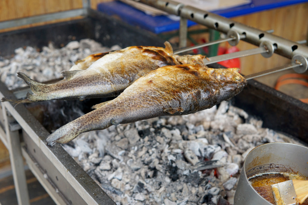 fish grilled over charcoal