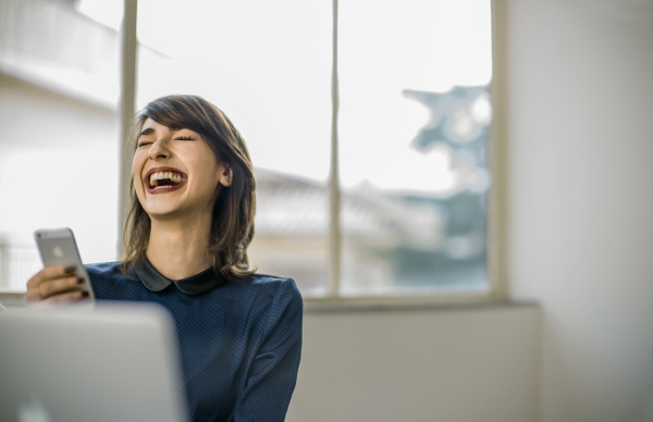 happy young woman laughing at a