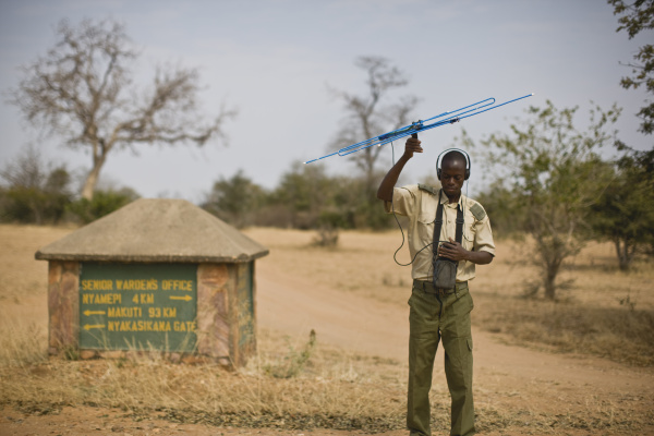 military man holding an aerial with