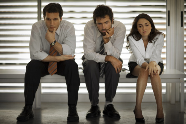 view of three pensive professionals