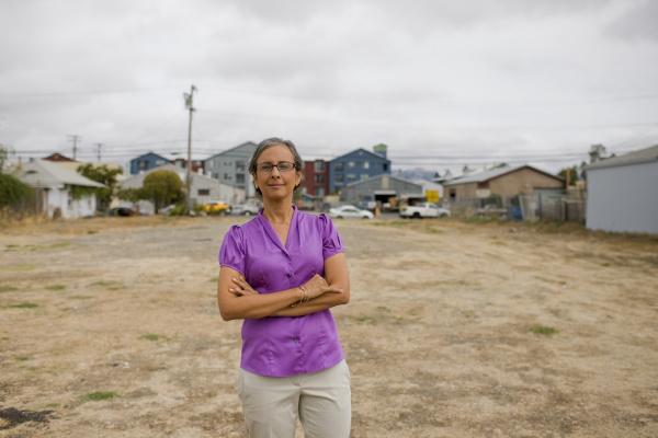 woman standing in empty lot