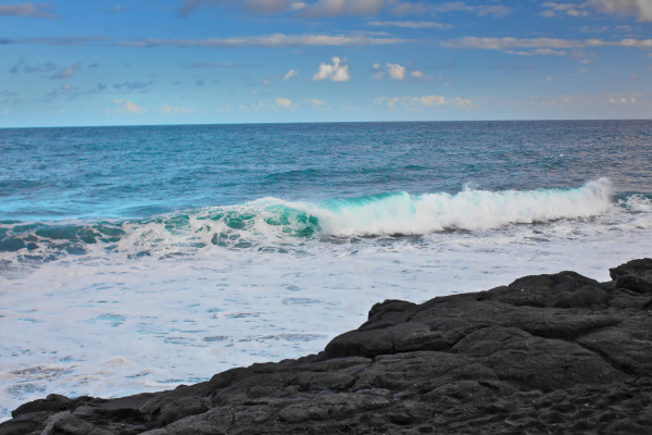 waves breaking onto a beach of