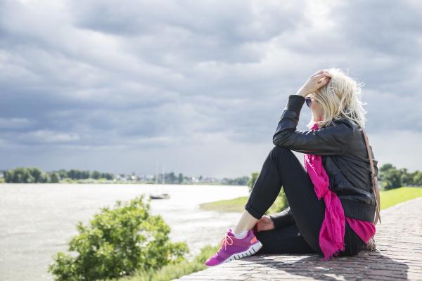 woman sitting on wall rhine