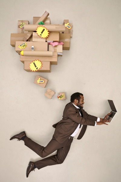 flying businessman shopping online