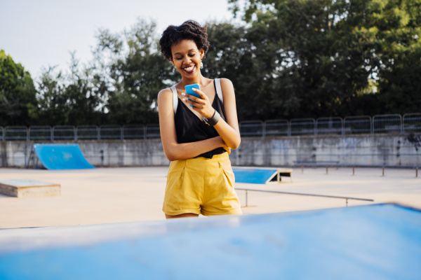 smiling young woman in a skatepark