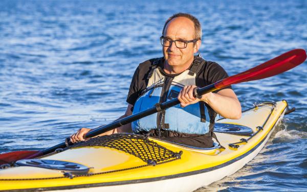 denmark senior man paddling
