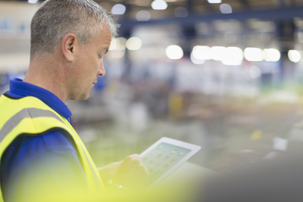 supervisor using digital tablet in steel