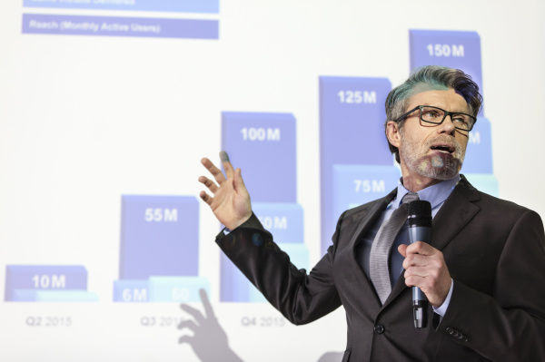 businessman with microphone speaking at projection