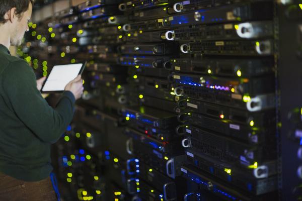server room technician using digital tablet