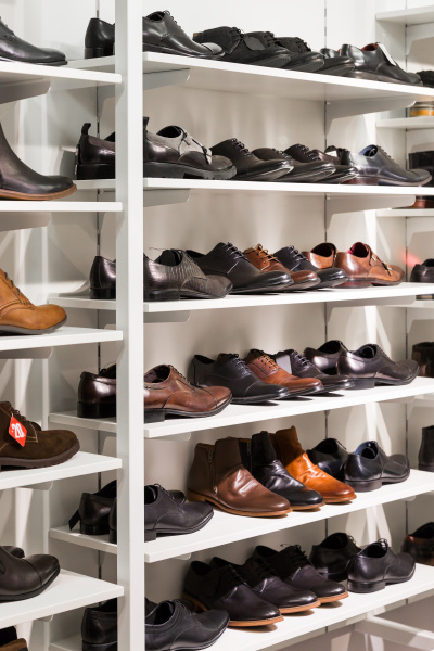 shelves with men s leather shoes