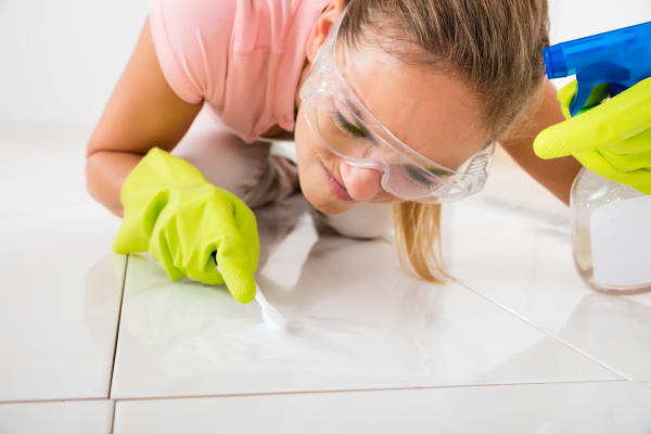stressed woman removing stain on the