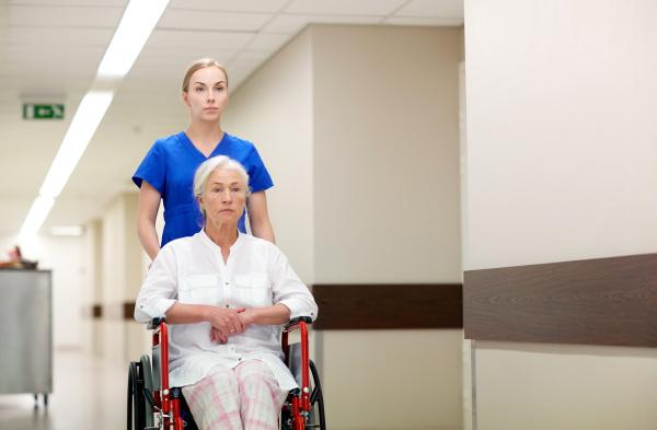 nurse with senior woman in wheelchair