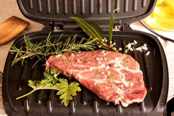 fleich with herbs on table grill