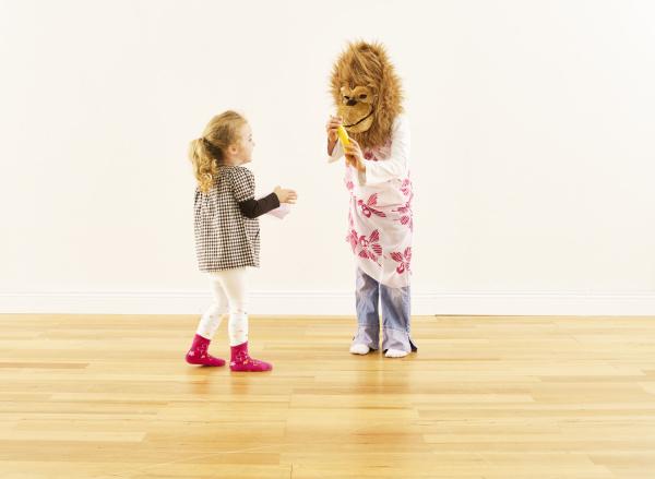 two girls having fun with monkey