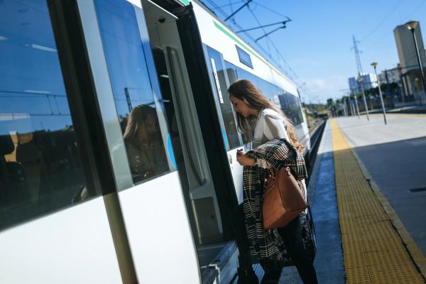woman entering a train