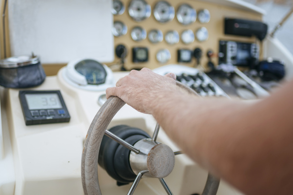 man steering motor boat close