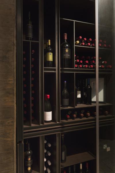 wine bottles organized on wooden shelves