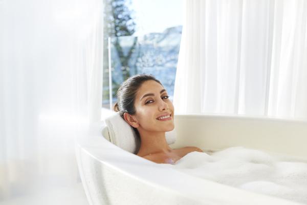 portrait smiling woman relaxing enjoying bubble