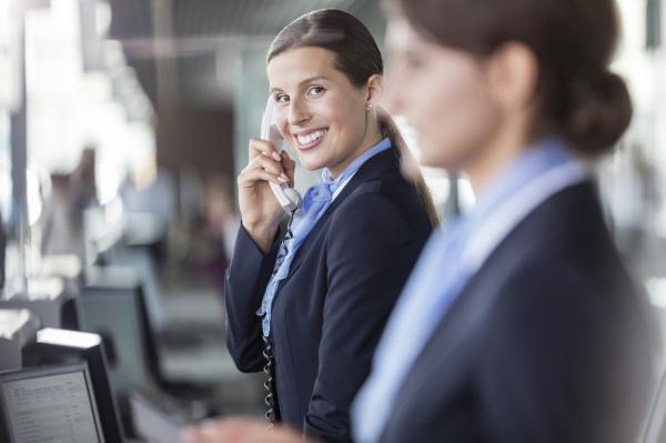 portrait smiling customer representative talking on