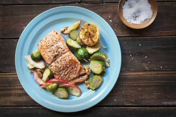 fried salmon with a brussels sprouts