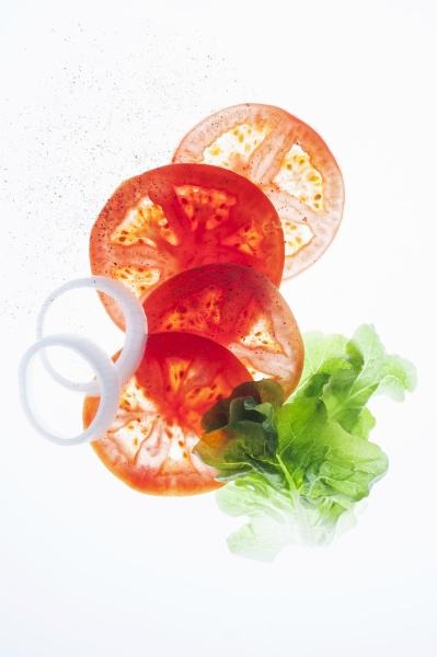 tomato slices onion rings and lettuce