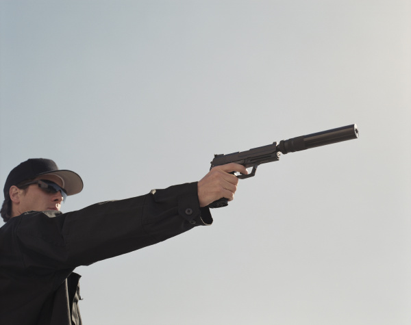 man in special forces aiming