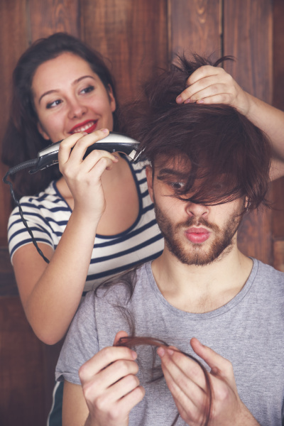 young man getting a haircut by