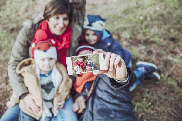 family taking a selfie with smartphone