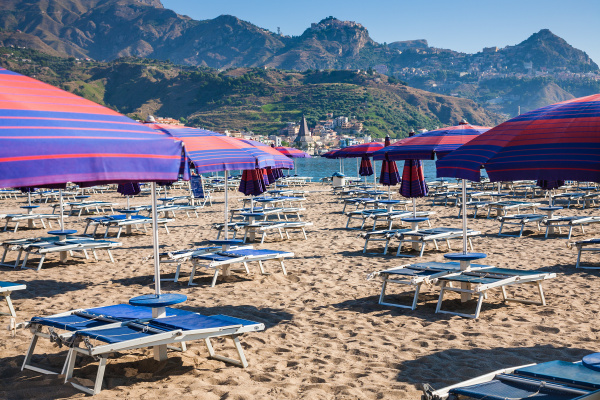 parasols and beds on urban beach