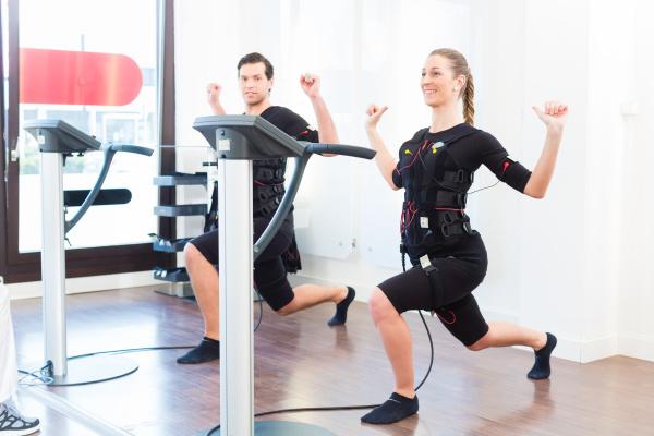 man and woman having ems training