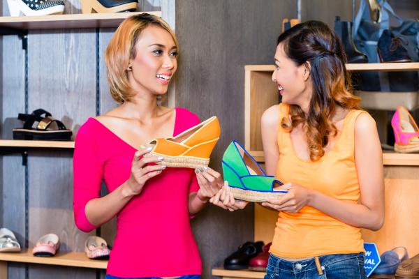 asian girl friends shoe shopping in