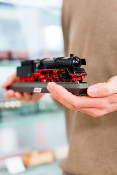 man buying model railroad in toy