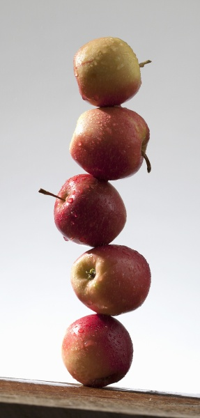 a stack of red apples with