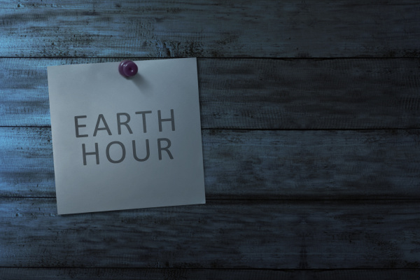 hanging note paper with earth hour