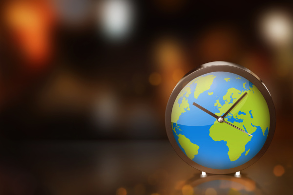 earth clock with blurred light on