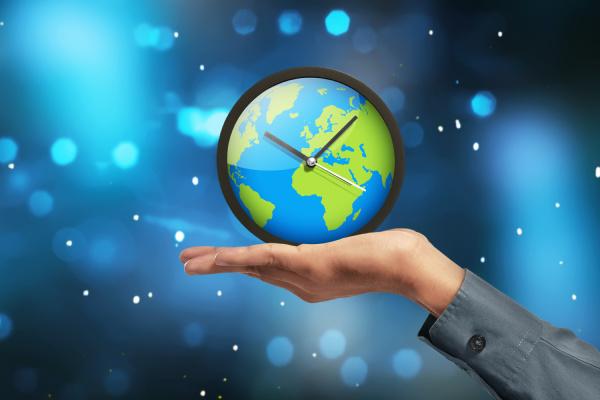people hand showing earth globe clock